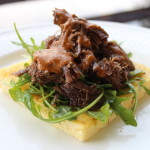 Braised Short Ribs and Arugula on Polenta Cake